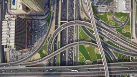 Long busy highway road in futuristic urban Dubai city panorama in amazing top aerial drone view