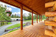 Long cabin horse farm house porch. Royalty Free Stock Photos