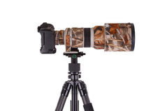 Long camouflages professional supertele on tripod Stock Photo