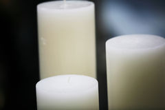 Long Candles. Soft romantic light with white candles Stock Photo
