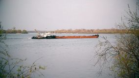 Long cargo barge on a river stock video