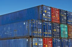 Long cargo containers. Maximum size cargo containers long view stacked at the offloding maritime transport dock holding area. commerce finance import export royalty free stock photo