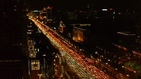 Long cars troop on busy overpass,aerial view of night traffic pollution in city. stock video