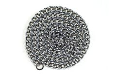 Long chain folded ring. Long silver chain twisted ring Royalty Free Stock Photo