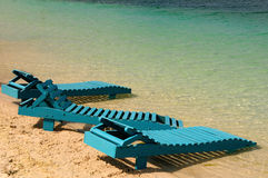 Long chairs. Blue long chairs at seashore beach ready to use Royalty Free Stock Image