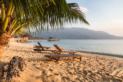 Long chairs on a beach in Pulau Tioman, Malaysia Stock Photography