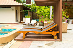 Long chairs by the pool Stock Image