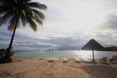 Long chairs under the sun. On the beach stock photos