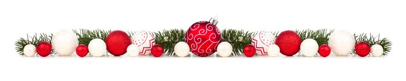 Free Long Christmas Border Of Red And White Ornaments And Branches Isolated On White Royalty Free Stock Images - 129965069