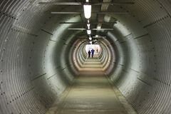 A long circular pedestiran tunnel sheeted in corrugated metal Royalty Free Stock Photography