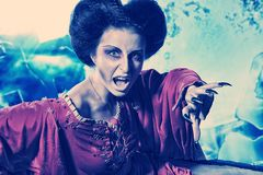 Long claws. Portrait of a bloodthirsty female vampire Royalty Free Stock Image