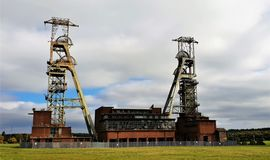 The long closed Coal Pit head at Kings Clipstone in Nottinghamshire. The long closed Coal Pit head mining site at Kings Clipstone Nottinghamshire stock photos