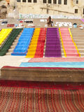 Long cloths drying at the Ganges, Varanasi. Long colorful cloth laying to dry on the ghats at the Ganges river in Varanasi, India royalty free stock image