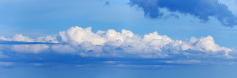 Long cloud in sky - panoramic photo Stock Photos