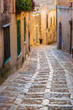 Long cobblestone street in Erice, Sicily, Italy, at sunset royalty free stock image