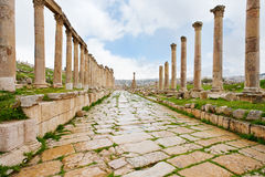 Long colonnaded street in antique town Jerash Royalty Free Stock Image