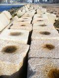 Long concrete Breakwater. Concrete blocks along beach Royalty Free Stock Image