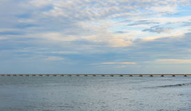 Long concrete bridge over the water at the sea. Khlong Yai, Thailand Royalty Free Stock Image