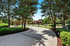 Long concrete driveway of American luxury house Royalty Free Stock Images