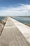 Long concrete jetty with sea and blue sky Royalty Free Stock Photo