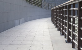 Long concrete pathway and metal fence Royalty Free Stock Photo