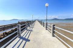 Long concrete pier at the sea in Phuket Royalty Free Stock Photo
