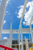 Long concrete pillars are going into beautiful sky, concrete joi Royalty Free Stock Photos