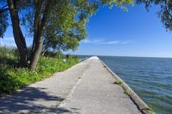 Long concrete sea pier Stock Photo