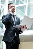 Long conversation. Successful businessman standing in the middle Royalty Free Stock Photos