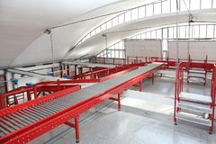 Express Delivery Sorting. Long Conveyor Belt in Distribution and Delivery Warehouse stock photography