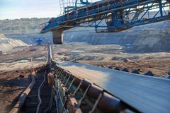 Long conveyor belt transporting ore Stock Photo