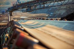 Long conveyor belt transporting ore Royalty Free Stock Photo
