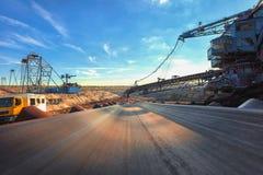 Long conveyor belt transporting ore Royalty Free Stock Photos