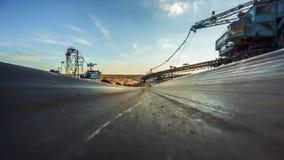 Long conveyor belt transporting ore Royalty Free Stock Images