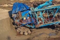 Long conveyor belt transporting ore Royalty Free Stock Image