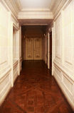 Long corridor. With a beautiful door Stock Images