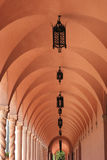 Long Corridor. A long corridor with black wrought iron lanterns hanging from the ceiling Royalty Free Stock Photo