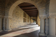 Long Corridor of Archies. Long Corridor of Arches along an opened courtyard Royalty Free Stock Photo