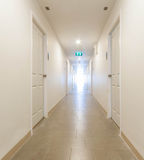 Long corridor building hallway Stock Photo