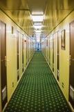 Long corridor of cruise ship. Yellow and brown walls and doors Stock Photography