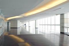 Long corridor. Empty long corridor in the modern office building Royalty Free Stock Photos