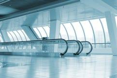 Long corridor with escalators Royalty Free Stock Image