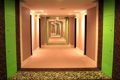 A long corridor with green inserts, lighting and carpeting stock photo