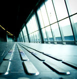 Long corridor with handicap strip Royalty Free Stock Photo