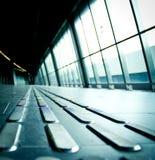 Long corridor with handicap strip Royalty Free Stock Photo