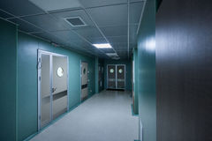 Long corridor in hospital. With doors and reflections Stock Images
