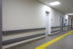 Long corridor in hospital. Clinic Stock Photos