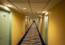 Long corridor of the hotel. The long corridor of the modern hotel extends to infinity royalty free stock image