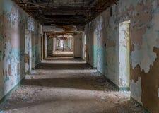 Long corridor inside Trans-Allegheny Lunatic Asylum. Empty rooms off long corridor inside Trans-Allegheny Lunatic Asylum in Weston, West Virginia, USA stock photo