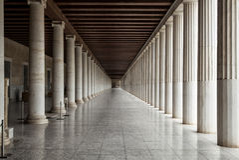 Long corridor between many columns.  Royalty Free Stock Photography